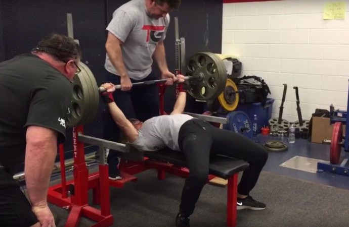 Watch this woman bench press 325 pounds in front of an entire college football team