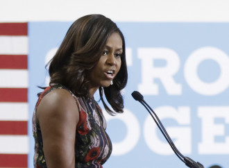 Michelle Obama jabs at Trump's 'birther' conspiracy while stumping for Clinton