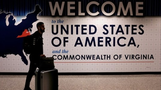 Travel ban takes effect but less chaos expected