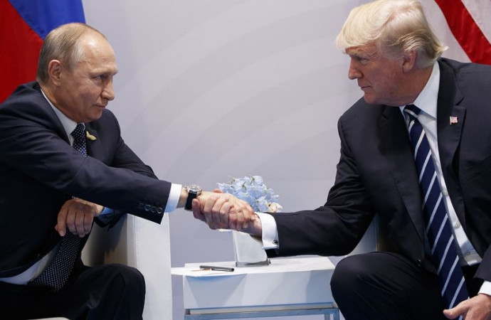Trump confronts Putin on election hacking in first meeting